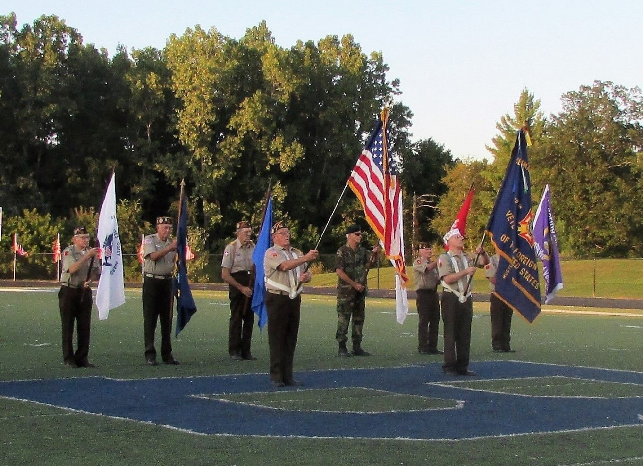 Honor guard presenting colors at the Ortonville football game's Hero's night.